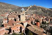 General view of Cathedral and Ramparts, Albarracin, Teruel, Spain, on February 13, 2006, pictured in the morning. The Cathedral, 1572-1600, was built by Martin de Castaneda, Pierres Vedel, and Alonso del Barrio de Ajo, in the Levantine Gothic style. Albarracin, a beautiful village with National Monument status overlooking the Guadalivar River, lies 28 km from Teruel, in the National Park in the Montes Universales. It is on the border of three Spanish Kingdoms: Castille, Aragon and Valencia, has been occupied for hundreds of years and is known as the Eagles` Nest because it  is built on a steep outcrop of rock surrounded by a deep gorge, a natural defence. Its buildings show  Moorish influence and even the name may derive from  the Berber clan Banu Razin who settled in the area during the 9th century. Picture by Manuel Cohen.