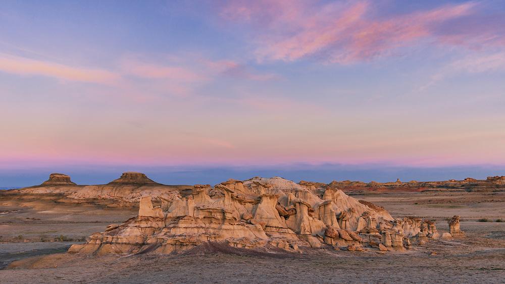 A picture of a group of sandstone hoodoos at sunrise in the Bisti Badlands.<br /> <br /> Camera <br /> NIKON D610<br /> Lens <br /> TAMRON SP 35mm F1.8 Di VC USD F012N<br /> Focal Length <br /> 35<br /> Shutter Speed <br /> 1/45<br /> Aperture <br /> 5.6<br /> ISO <br /> 220
