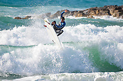 Surfer spins on the crest of a wave Photographed in the Mediterranean Sea, Tel Aviv Israel