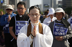 April 28, 2017 - Seoul, South Korea - Protesters pray for peace during a demonstration against the Terminal High Altitude Area Defense (THAAD) in Seoul. South Korean people and religious figures gathered in central Seoul to protest for the removal of the Terminal High Altitude Area Defense (THAAD) from their territory and bring peace to the Korean Peninsula. (Credit Image: © Yao Qilin/Xinhua via ZUMA Wire)