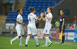 CARDIFF, WALES - Tuesday, August 21, 2014: England's Karen Carney celebrates scoring her sides first goal against Wales during the FIFA Women's World Cup Canada 2015 Qualifying Group 6 match at the Cardiff City Stadium. (Pic by Ian Cook/Propaganda)