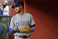 Aug 11, 2017; Phoenix, AZ, USA; Chicago Cubs infielder Kris Bryant (17) looks up while preparing his glove in the dugout prior to the MLB game against the Arizona Diamondbacks at Chase Field. Mandatory Credit: Jennifer Stewart-USA TODAY Sports