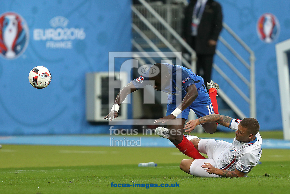 Moussa Sissoko of France is fouled by Ragnar Sigurdsson of Iceland during the quarter final match at Stade de France, Paris<br /> Picture by Paul Chesterton/Focus Images Ltd +44 7904 640267<br /> 03/07/2016