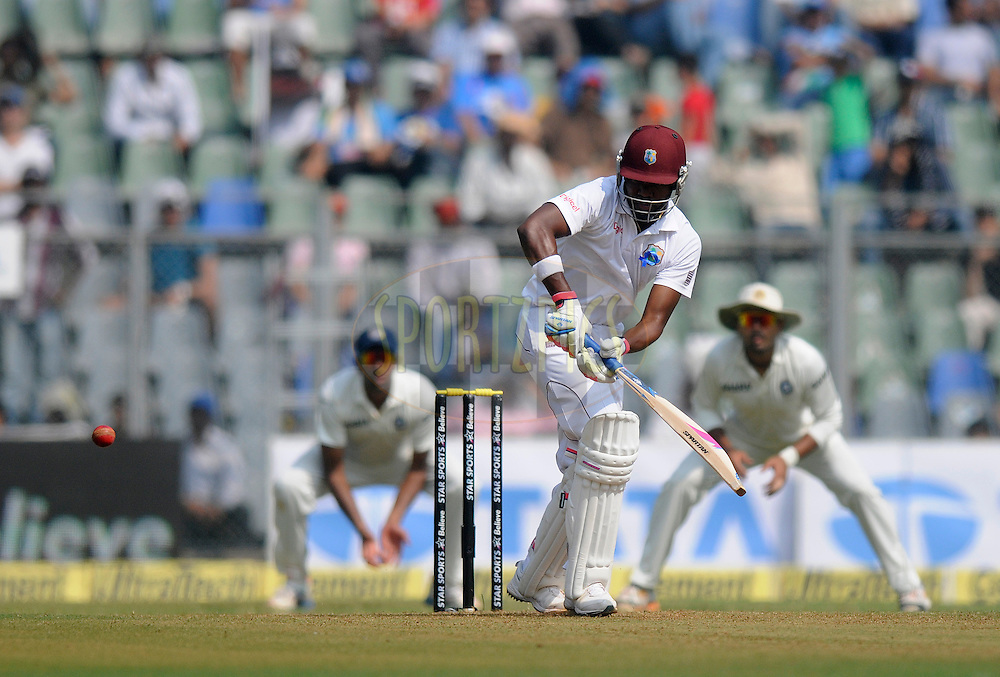 Darren Bravo of West Indies bats during day one of the second Star Sports test match between India and The West Indies held at The Wankhede Stadium in Mumbai, India on the 14th November 2013<br /> <br /> This test match is the 200th test match for Sachin Tendulkar and his last for India.  After a career spanning more than 24yrs Sachin is retiring from cricket and this test match is his last appearance on the field of play.<br /> <br /> Photo by: Pal PIllai - BCCI - SPORTZPICS<br /> <br /> Use of this image is subject to the terms and conditions as outlined by the BCCI. These terms can be found by following this link:<br /> <br /> http://sportzpics.photoshelter.com/gallery/BCCI-Image-Terms/G0000ahUVIIEBQ84/C0000whs75.ajndY