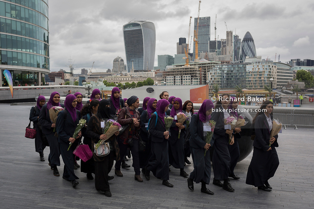 Two days after the London Bridge and Borough Market terrorist attack, Londoners from all faiths and religions attended a vigil outside City Hall, on Monday 5th June 2017, in the south London borough of Southwark, England. Teenage students from Eden Girls, Waltham Forest participated while a prominent armed police presence guarded dignitaries and the public who came to the Southbank to remember the seven killed and many others left with life-changing injuries. The British spirit of defiance and to carry on with every day life, endures.