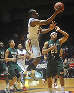 "Ole Miss guard Zach Graham (32)  drives past Mississippi Valley State's Kevin Burwell (25) at C.M. ""Tad"" Smith Coliseum in Oxford, Miss. on Monday, December 13, 2010."