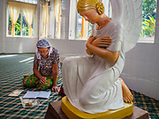 28 NOVEMBER 2017 - YANGON, MYANMAR: A woman prays in a chapel at St. Francis of Assisi Church in Yangon. About 1,500 people are camping at the church before the papal mass at Kyaikkasan Sports Ground, about three kilometers from the church.      PHOTO BY JACK KURTZ
