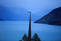 A statue of a skewered fish on a church spire in Queenstown, South Island, New Zealand