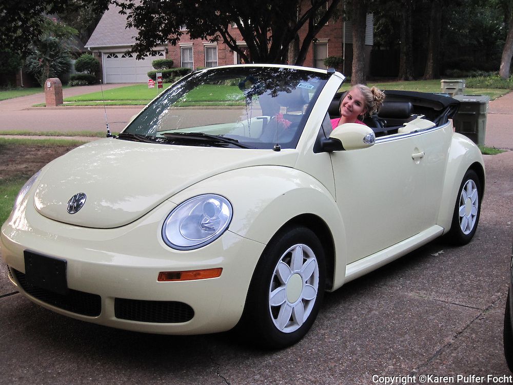 2006 Volkswagen Beetle with daisy hub caps, in Memphis, Tennessee.