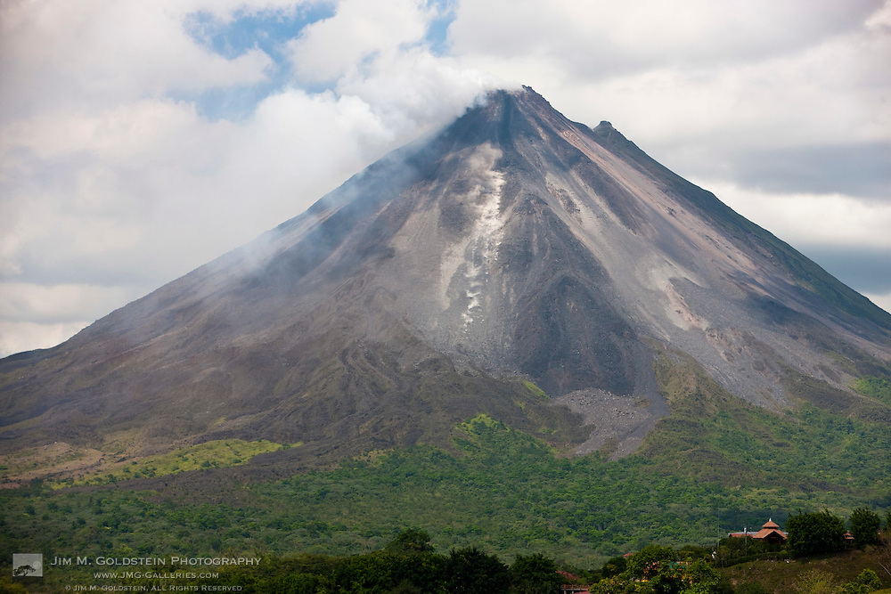 Lava rocks are thrown from the erupting Arenal volcano to the mountainside and forest below in Arenal, Costa Rica