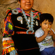 Zuni Native American mother dressed in traditional regalia with young toddler, Flagstaff, AZ