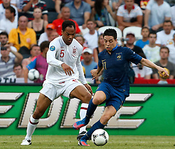Joleon Lescott tight and Samir Nasrii during the 1-1 draw in the Group D Match Against France AT The Euro 2012 Football Championships in Donetsk, Ukraine, June 11 2012. Photo By Imago/i-Images