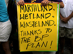 30 May 2010. New Orleans, Louisiana, USA.  <br /> Protesters and their signs at an anti BP rally in Jackson Square.<br /> Photo; Charlie Varley<br /> www.varleypix.com