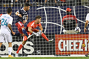 CHICAGO, IL - AUGUST 02: MLS All-Star Dom Dwyer (14) heads the ball in for a goal against Real Madrid goalkeeper Luca Zidane in the second half during a soccer match between the MLS All-Stars and Real Madrid on August 2, 2017, at Soldier Field, in Chicago, IL. The game ended in a 1-1 tie with Real Madrid winning on penalty kicks 4-2. (Photo by Patrick Gorski/Icon Sportswire)