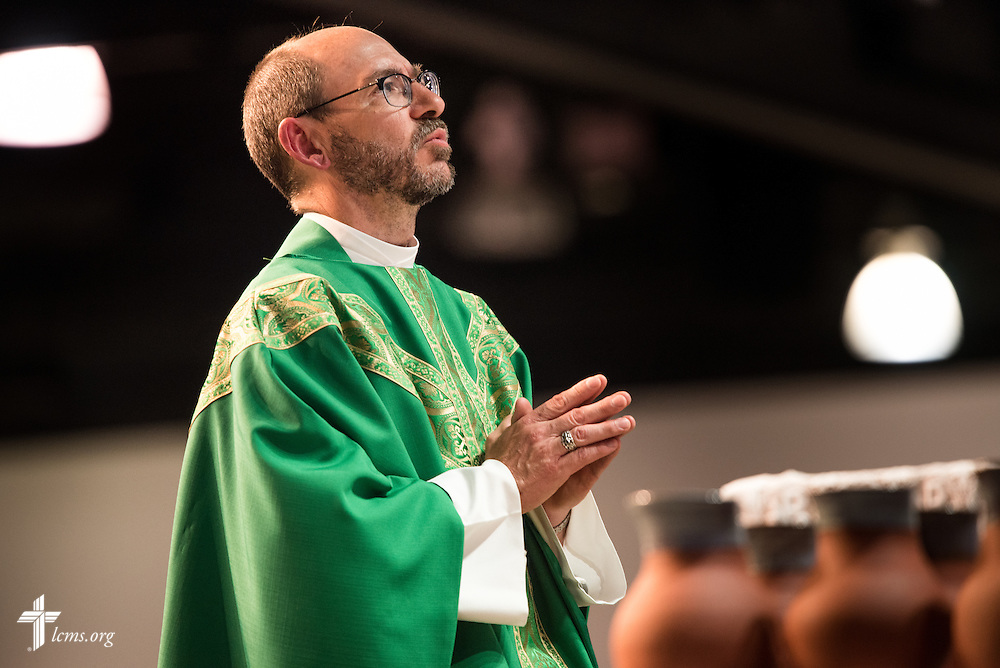 The Rev. Peter C. Bender, pastor of Peace Lutheran Church in Sussex, Wis., prays during the Opening Divine Service of the 66th Regular Convention of The Lutheran Church–Missouri Synod on Saturday, July 9, 2016, at the Wisconsin Center in Milwaukee. LCMS/Frank Kohn