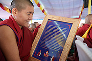 citation of gratitude to His Holiness and presented him with a framed copy illustrated and printed in traditional ornamental style of gold on blue at Drepung Lachi in Mundgod, Karnataka, India on December 22, 2016.