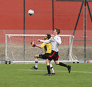 Dundee Thistle's Craig Hay goes past the DUMS keeper on his way to scoring the clinching goal - Dundee Thistle (white) v DUMS (red and black) - Dundee Saturday Morning Football League Ross Kirk Memorial Cup Final at GA Arena<br /> <br />  - &copy; David Young - www.davidyoungphoto.co.uk - email: davidyoungphoto@gmail.com
