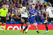 Chelsea midfielder Jorginho (5) and Valencia CF midfielder Geoffrey Kondogbia (6) clash over the ball during the Champions League match between Chelsea and Valencia CF at Stamford Bridge, London, England on 17 September 2019.