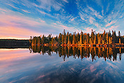 Reflection at sunset of boreal forest in Graphic Lake<br /> Graphic Lake near Kenora<br /> Ontario<br /> Canada