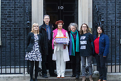Downing Street, London, March 15th 2017. Bianca Jagger joins Bianca Jagger will join Peter Tatchell and others to hand in a 159,000-signature petition that urges the UK government to halt arms sales to Saudi Arabia over its war crimes in Yemen and its jailing of blogger Raif Badawi and other political prisoners, to Prime Minister Theresa May at 10 Downing Street. PICTURED: Peter Tatchell, Bianca Jagger, Jenny Jones together with other members of the petitioning team.