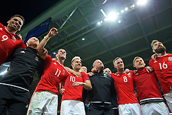 LILLE, FRANCE - Friday, July 1, 2016: Wales players celebrate in the team huddle following a 3-1 victory over Belgium and reaching the Semi-Final during the UEFA Euro 2016 Championship Quarter-Final match at the Stade Pierre Mauroy. Hal Robson-Kanu, physiotherapist Sean Connelly, Gareth Bale, Aaron Ramsey, goalkeeping coach Martyn Margetson, Andy King, George Williams, Joe Ledley. (Pic by David Rawcliffe/Propaganda)
