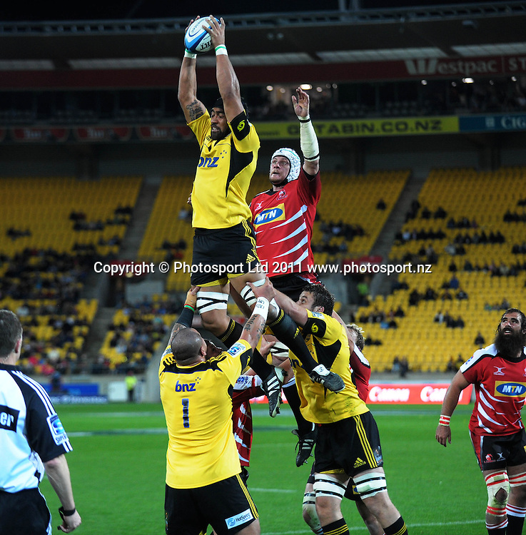 Victor Vito beats Lions lock Wikus Van Heerden to lineout ball. Super 15 rugby match - Hurricanes v Lions at Westpac Stadium, Wellington, New Zealand on Saturday, 4 June 2011. Photo: Dave Lintott / photosport.co.nz