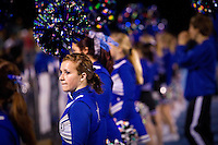 Felicia looks out toward the crowd as she takes part in her first football game as a Coeur d'Alene High School cheerleader Friday, Sept. 24, 2010.