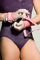 Gymnast Putting on Palm Guards