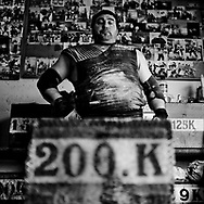 """Juan Jose Unanua """"Goenatxo"""", stone lifter or harrijasotzaile in Basque language. Concentrates before he lifts a 200 k stone while training at home in Azkoitia. Basque rural sports (Herri Kirolak in basque language) are rooted in traditional lifestyles, mostly farmer occupations of the Basque Country, in Northern Spain. Nowadays they have transform themselves into sports based in strenght and skill. Stone lifting and wood chopping are the most popular."""