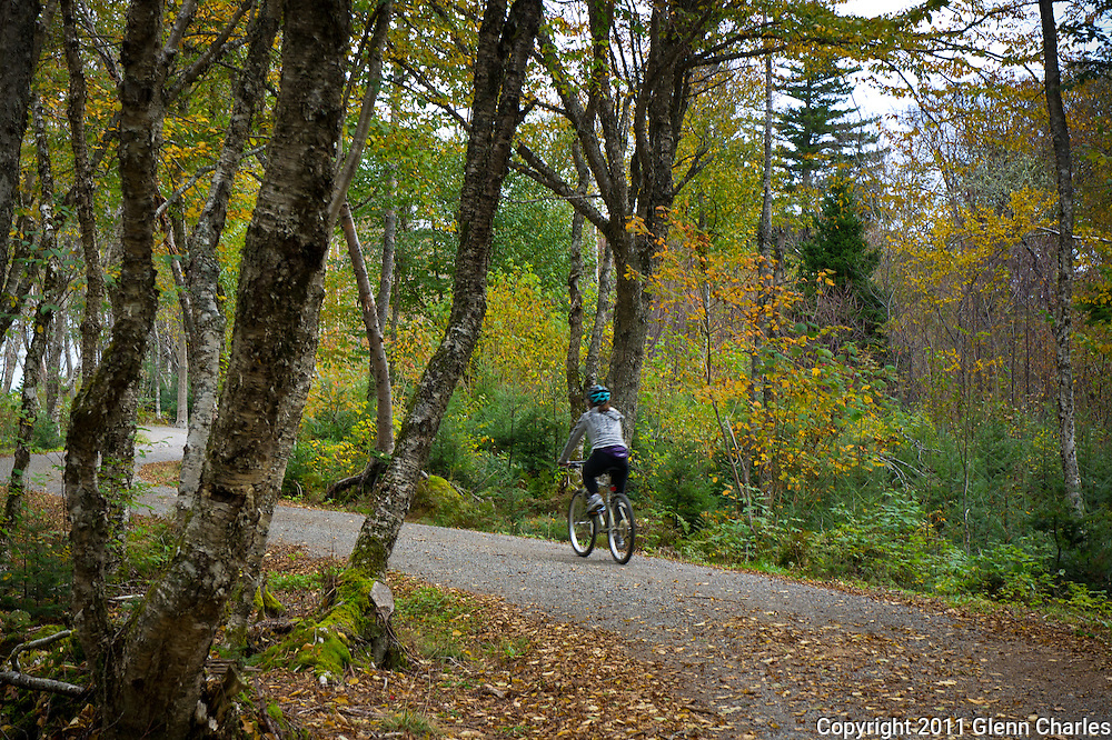 A lone rider enjoys mountain biking the historic carriage trails on Campobello Island in the Roosevelt International Park.