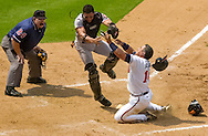 Andres Galarraga (R) of the Atlanta Braves is out at the plate after a collision with San Francisco Giants catcher Bobby Estalella.