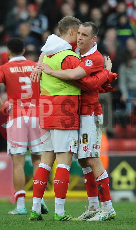 Bristol City's Matt Smith hugs Bristol City's Aaron Wilbraham after the game - Photo mandatory by-line: Dougie Allward/JMP - Mobile: 07966 386802 - 28/02/2015 - SPORT - football - Bristol - Ashton Gate - Bristol City v Rochdale AFC - Sky Bet League One
