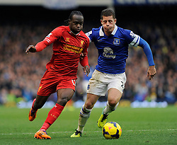 Liverpool's Victor Moses is challenged by Everton's Ross Barkley - Photo mandatory by-line: Dougie Allward/JMP - Tel: Mobile: 07966 386802 23/11/2013 - SPORT - Football - Liverpool - Merseyside derby - Goodison Park - Everton v Liverpool - Barclays Premier League