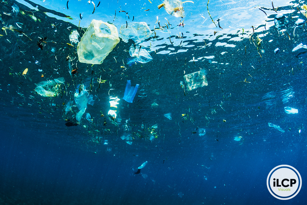Changing tides bring ocean plastic pollution together off shore in Indonesia.