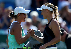 Denmark's Caroline Wozniacki (right) shakes hands with Australia's Ashleigh Barty after winning her match during day five of the Nature Valley International at Devonshire Park, Eastbourne.