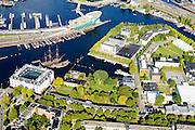 Nederland, Noord-Holland, Amsterdam, 27-09-2015; Kattenburg en Oosterdok. Overzicht Marineterrein en omgeving, linksbeneden het Scheepvaartmuseum. Verder de IJtunnel en museum Nemo.<br /> View on Navy area (center) and the National Maritime Museum (left, white building). Museum Nemo (copper green) near central station. <br /> <br /> luchtfoto (toeslag op standard tarieven);<br /> aerial photo (additional fee required);<br /> copyright foto/photo Siebe Swart