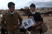 Banda Aceh, Northern Sumatra, Indonesia.<br />Site of the worst destruction of the Boxing day 2004 Looking for missing relatives