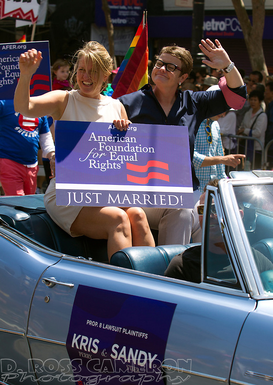 Prop 8 plaintiffs Kris Perry, left, and Sandy Stier ride in the back of a convertible at the 43rd annual San Francisco Pride parade, Sunday, June 30, 2013 in San Francisco. (Photo by D. Ross Cameron)