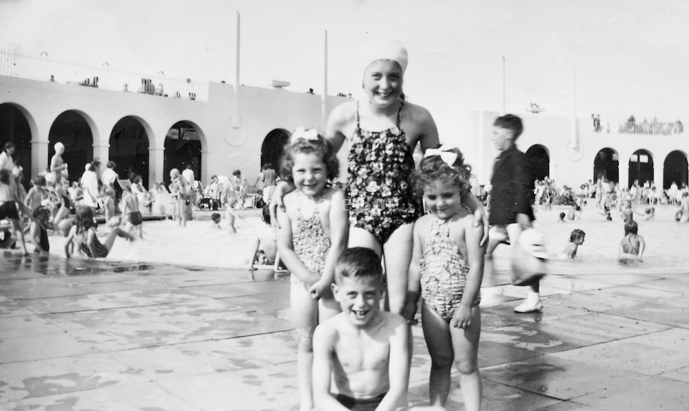 children at a swimming pool England 1951