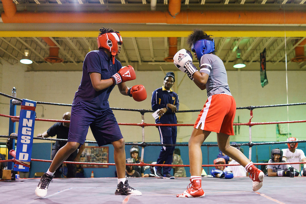 iBaltimore, Maryland - January 26, 2017: Aiyahnah &ldquo;Stringbean The Dream Killa&rdquo; Burke, 15,  spars with Mia &quot;Killer Bee&quot; Ellis, 16, at the Upton Boxing Club in Baltimore. Coach Calvin Ford watches in the middle.<br /> <br /> <br /> CREDIT: Matt Roth for The New York Times<br /> Assignment ID: