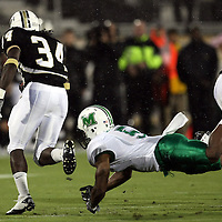 Central Florida running back Brynn Harvey (34) runs past Rashad Jackson (5)  during an NCAA football game between the Marshall Thundering Herd and the Central Florida Knights at Bright House Networks Stadium on Saturday, October 8, 2011 in Orlando, Florida. (Photo/Alex Menendez)