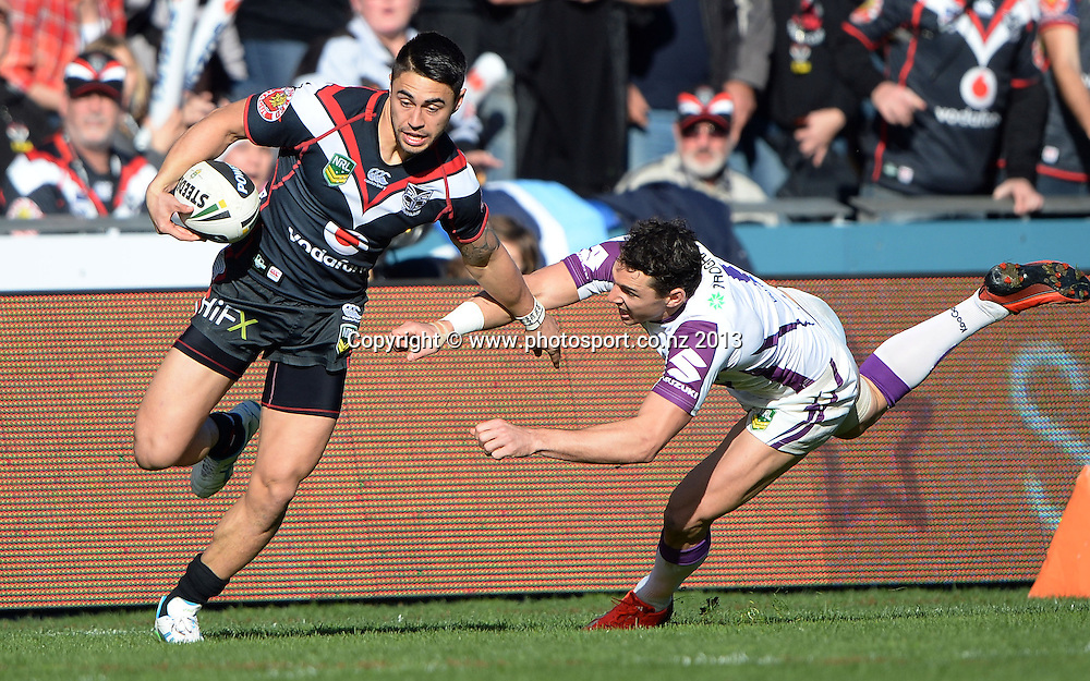 Shaun Johnson breaks away from Billy Slater. NRL Rugby League match, Vodafone Warriors v Melbourne Storm at Mt Smart Stadium in Auckland on Sunday 28 July 2013. Photo: Andrew Cornaga/Photosport.co.nz