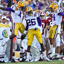 November 6, 2010; Baton Rouge, LA, USA; LSU Tigers cornerback Tharold Simon (26) cornerback Jai Eugene (4) and cornerback Tyrann Mathieu (14) celebrate a defensive stop during the second half against the Alabama Crimson Tide at Tiger Stadium. LSU defeated Alabama 24-21.  Mandatory Credit: Derick E. Hingle