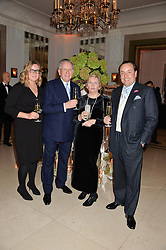 Left to right, CELIA WILLIAMS, JOHN HITCHCOCK, MARGARET HITCHCOCK and STEVEN HITCHCOCK at a reception hosted by Wei Koh founder of The Rake Magazine and Thomas Kochs General Manager of Claridge's to celebrate London Collections: Man 2014 at Claridge's, Brook Street, London on 5th January 2014.