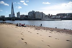 © Licensed to London News Pictures. 14/03/2019. London, UK. Changeable weather sweeps up river effecting commuters and tourists, as they are hit by rain, high winds and blinding sun in the space of one hour. Photo credit: Guilhem Baker/LNP