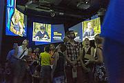 Visitors in the first room - pre-show - of the exhibition route that runs through the &quot;Fields of ideas&quot; at German Pavilion in Expo 2015, Rho-Pero, Milan in July 2015. On the screens thematic ambassadors, German militants of environmental issues. &copy; Carlo Cerchioli<br />  <br /> Visitatori nella prima stanza - il pre show - della mostra che attraversa i &quot;Campi delle idee&quot; al padiglione tedesco in Expo 2015, Rho-Pero, Milano luglio 2015. Sugli schermi gli ambasciatori tematici, militanti tedeschi di temi ambientali.
