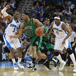 11 February 2009:  Boston Celtics forward Paul Pierce (34) drives past Hornets defenders James Posey (41) and Chris Paul (3) during a 89-77 loss by the New Orleans Hornets to the Boston Celtics at the New Orleans Arena in New Orleans, LA.