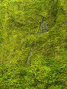 Wai' ale' ale Waterfalls - Aerial view of Kauai, Hawaii on a cloudy day.