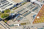 Nederland, Noord-Holland, Amsterdam, 09-04-2014; luchthaven Schiphol. Stationsgebouw. parkeerterrein en diverse kantoorgebouwen geexploiteerd door Schiphol vastgoed (Schiphol Real Estate). Schiphol Airport. Terminal building and office buildings operated by Schiphol Real Estate (SRE). <br /> luchtfoto (toeslag op standard tarieven);<br /> aerial photo (additional fee required);<br /> copyright foto/photo Siebe Swart.
