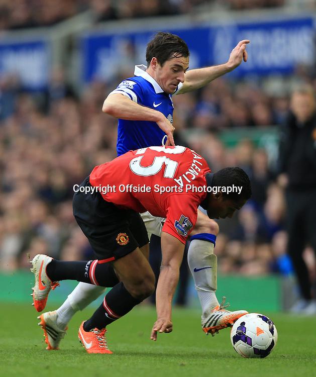 20th April 2014 - Barclays Premier League - Everton v Manchester United - Leighton Baines of Everton battles with Luis Antonio Valencia of Man Utd - Photo: Simon Stacpoole / Offside.